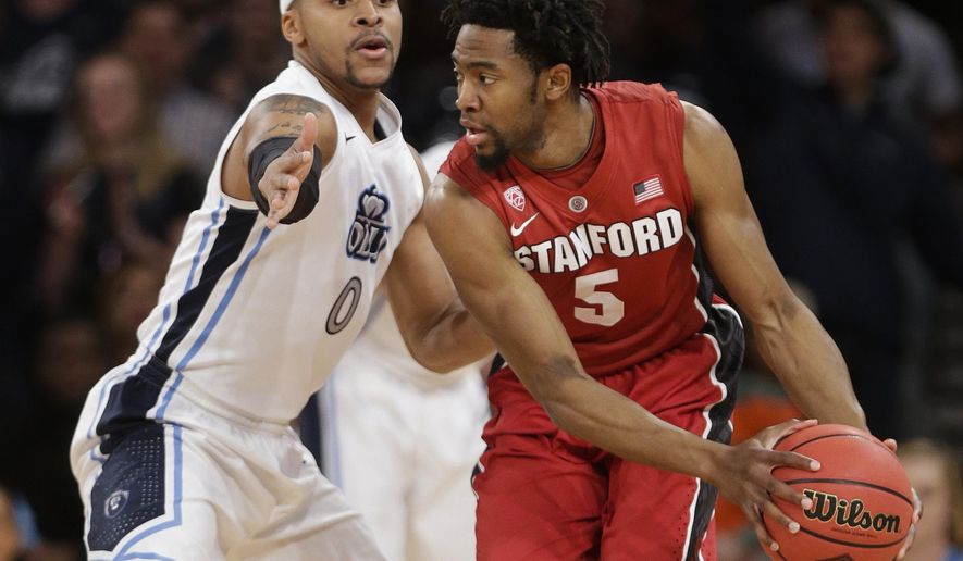 Stanford's Chasson Randle (5) protects the ball from Old Dominion's Jordan Baker during the first half of a semifinal at the NIT college basketball tournament Tuesday, March 31, 2015, in New York. (AP Photo/Frank Franklin II)