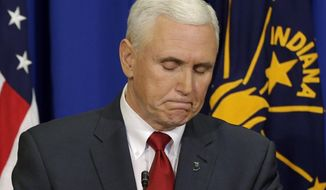 Indiana Gov. Mike Pence listens to a question during a news conference, Tuesday, March 31, 2015, in Indianapolis. Pence said that he wants legislation on his desk by the end of the week to clarify that a new religious-freedom law does not allow discrimination. The law has triggered an outcry, with businesses and organizations voicing concern and some states barring government-funded travel to the Midwestern state. (AP Photo/Darron Cummings)