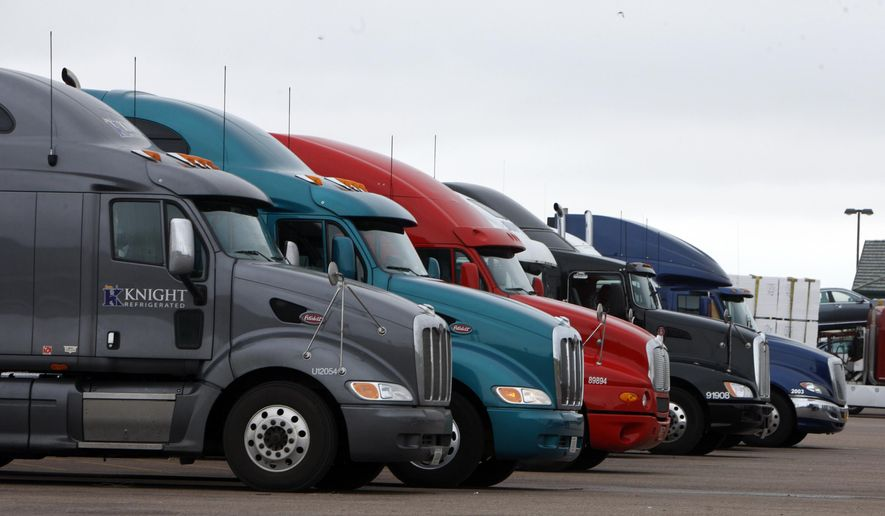 In this May 21, 2009, file photo, big rigs stack up at the Flying J Truck Stop along Interstate 70 near the small Colorado plains community of Limon. (AP Photo/David Zalubowski, File)