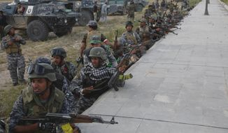 moving in: Iraqi fighters on Tuesday went house to house and street by street in search of snipers and booby traps to liberate the city from the Islamic State. Iraqi Prime Minister Haider al-Abadi said security forces reached the heart of the city. (Associated Press)
