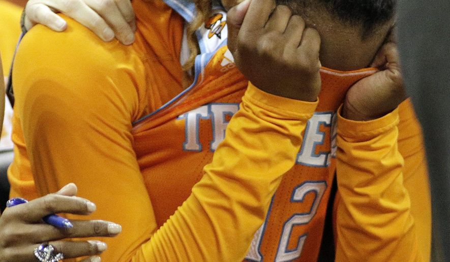 Tennessee's Bashaara Graves covers her face as time runs out during the second half of a women's college basketball regional final game against Maryland in the NCAA tournament, Monday, March 30, 2015, in Spokane, Wash. Maryland won 58-48. (AP Photo/Young Kwak)