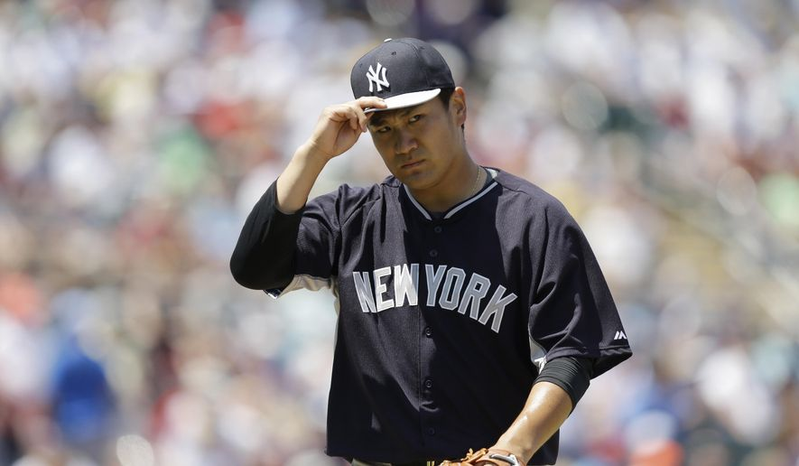 New York Yankees starting pitcher Masahiro Tanaka, walks off the field after he delivers against the Minnesota Twins in the second inning during an exhibition spring training baseball game, Tuesday, March 31, 2015, in Fort Myers, Fla. (AP Photo/Brynn Anderson)
