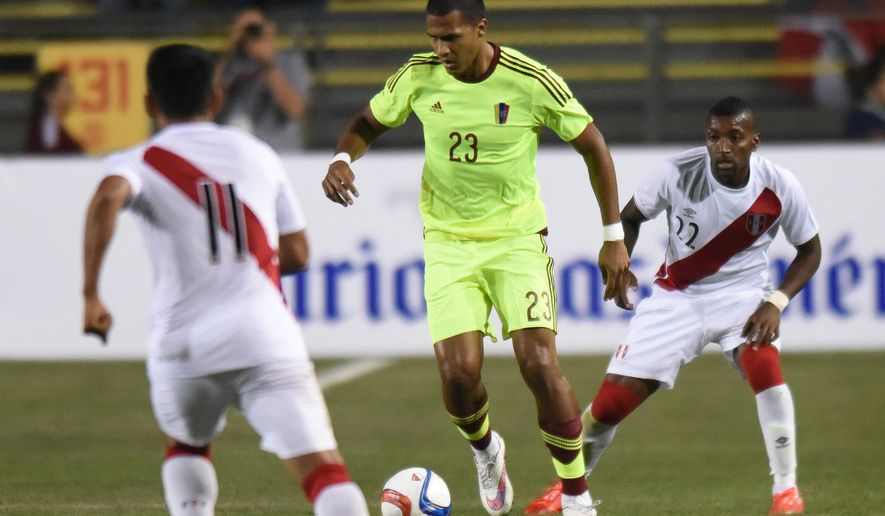 Salomon Rondon (23) of Venezuela passes the ball against Peru during a friendly soccer game at Lockhart Stadium in Fort  Lauderdale, Fla., on Tuesday, March 31, 2015. (AP Photo/South Florida Sun-Sentinel, Jim Rassol)  MAGS OUT