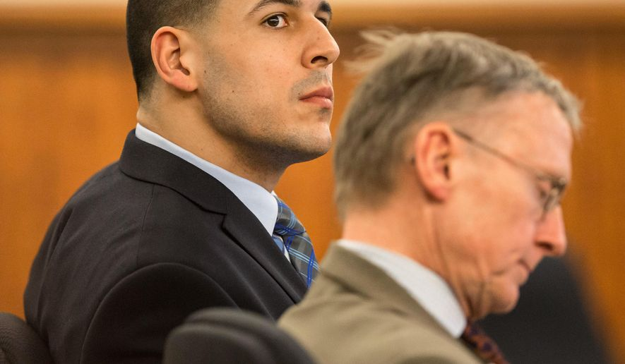 Former New England Patriots football player Aaron Hernandez, left, listens alongside his attorney Charles Rankin during his murder trial, Tuesday, March 31, 2015, at Bristol County Superior Court in Fall River, Mass. Hernandez is accused of killing Odin Lloyd in June 2013.  (AP Photo/The Boston Globe, Aram Boghosian, Pool)