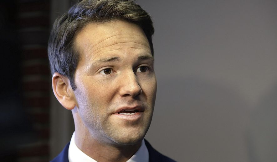 FILE - In this Feb. 6, 2015, file photo, Rep. Aaron Schock, R-Ill., speaks to reporters before meetings with constituents after a week in which he faced twin scandals in Peoria Ill. Some of Schock's current and previous employees will appear before a federal grand jury next month to answer questions about their old boss. They'll likely face a prosecutor with a tough, meticulous reputation.  (AP Photo/Seth Perlman, File)