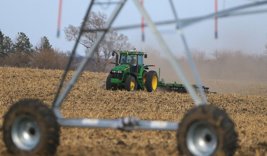 A farmer tills a field near Mead, Neb., Monday, March 30, 2015. The USDA releases its annual prospective planting report on Tuesday, March 31, 2015,  which outlines farmer decisions about how much land to dedicate to corn, soybeans and other major crops including wheat and cotton. (AP Photo/Nati Harnik)