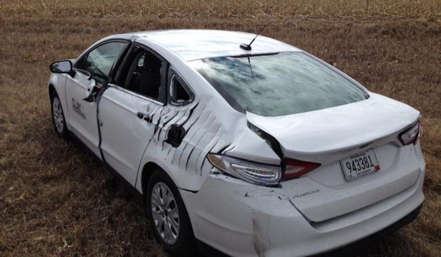 This photo provided by the Minnesota Department of Public Safety, shows a car following a collision with an aircraft near Hawley, Minn., Tuesday, March 31, 2015. The small aircraft collided with the car while making an emergency landing on a Minnesota highway. (AP Photo/Minnesota Department of Public Safety)