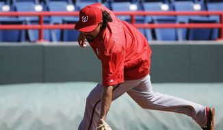Washington Nationals' Anthony Rendon fields ground balls during a spring training baseball workout, Sunday, Feb. 22, 2015, in Viera, Fla. (AP Photo/David Goldman)