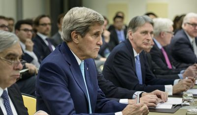 U.S. Secretary of State John Kerry, second left, U.S. Secretary of Energy Ernest Moniz, left, British Foreign Secretary Philip Hammond, center, Russian Deputy Foreign Minister Sergei Ryabkov, second right, and German Foreign Minister Frank Walter Steinmeier wait for the start of a meeting on Iran's nuclear program with other officials from France, China, the European Union and Iran at the Beau Rivage Palace Hotel in Lausanne, Switzerland Tuesday, March 31, 2015. (AP Photo/Brendan Smialowski, Pool)