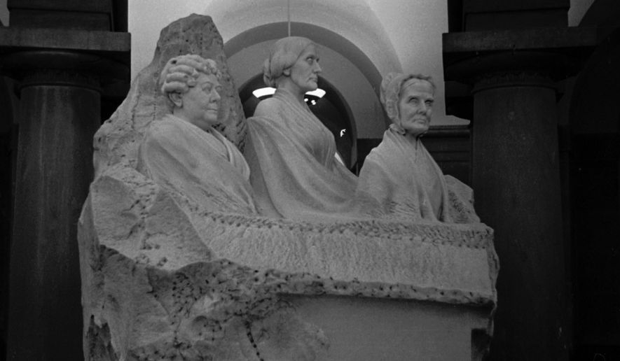"""""""Three Women in a Bathtub,"""" statue for women's suffrage in capitol crypt below the rotunda. This September 15, 1964, photo shows bust of Lucretia Mott, Elizabeth Cady Stanton and Susan B. Anthony rising from a block of white marble. (AP/Photo)"""