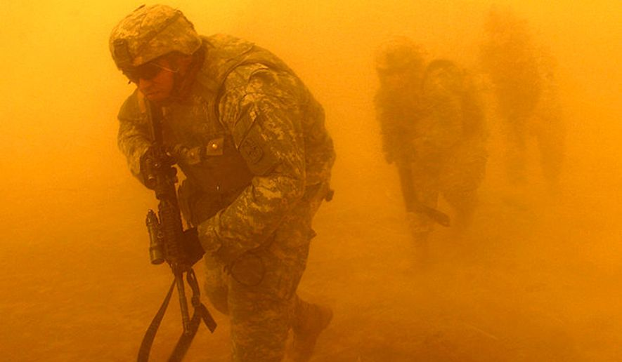 Soldiers from 4th Battalion, 23rd Infantry Regiment, 172nd Stryker Brigade Combat Team exit a UH-60 Black Hawk helicopter near Tall Afar, Iraq, July 2, 2006. (U.S. Air Force) ** FILE **