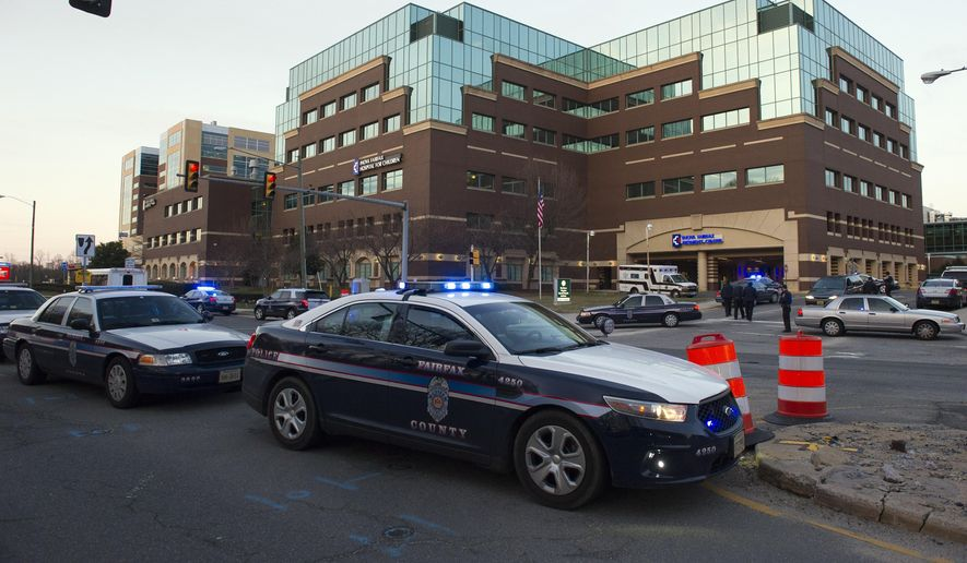 Fairfax County police investigate at Inova Fairfax Hospital in Falls Church, Va. (AP File Photo/Cliff Owen)