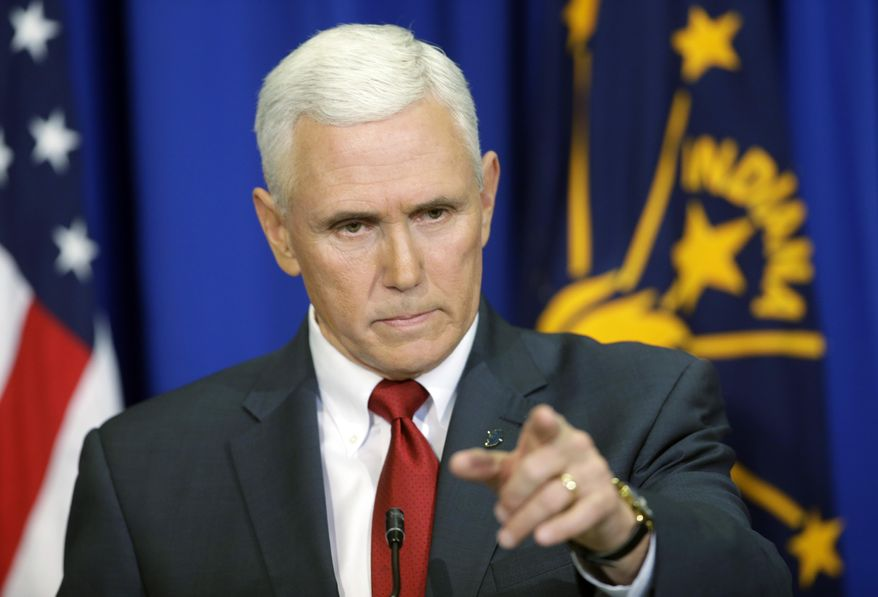 Indiana Gov. Mike Pence takes a question during a news conference, Tuesday, March 31, 2015, in Indianapolis. Pence said that he wants legislation on his desk by the end of the week to clarify that the state's new religious-freedom law does not allow discrimination against gays and lesbians. (AP Photo/Darron Cummings)