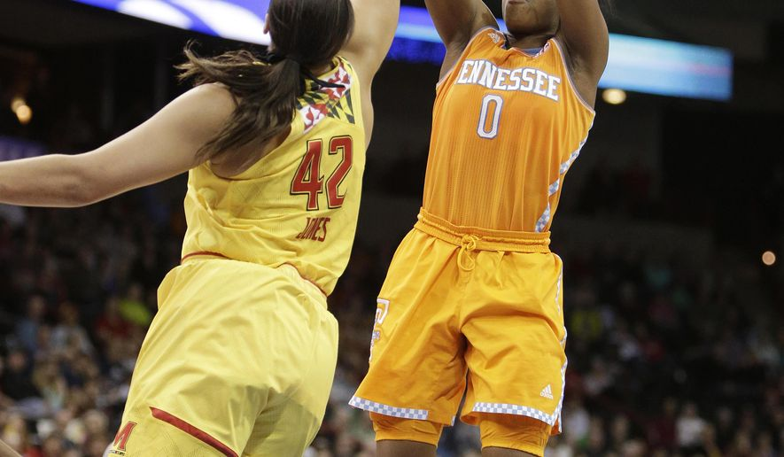 Tennessee's Jordan Reynolds (0) shoots against Maryland's Brionna Jones (42) during the second half of a women's college basketball regional final game in the NCAA tournament, Monday, March 30, 2015, in Spokane, Wash. Maryland won 58-48. (AP Photo/Young Kwak)
