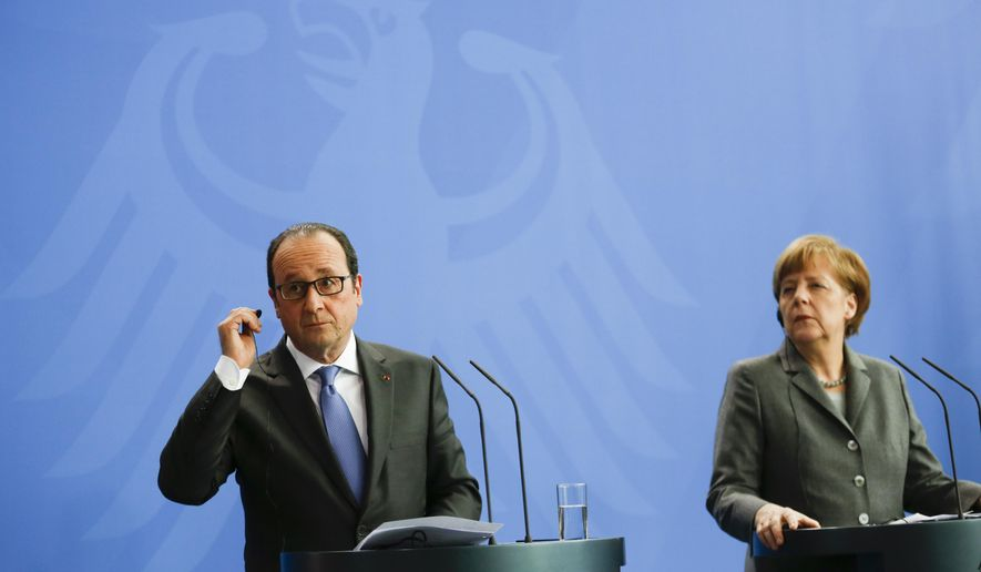 German Chancellor Angela Merkel, right, and French President Francois Hollande brief the media after a meeting of German and French ministers on Tuesday, March 31, 2015 in the chancellery in Berlin. (AP Photo/Markus Schreiber)
