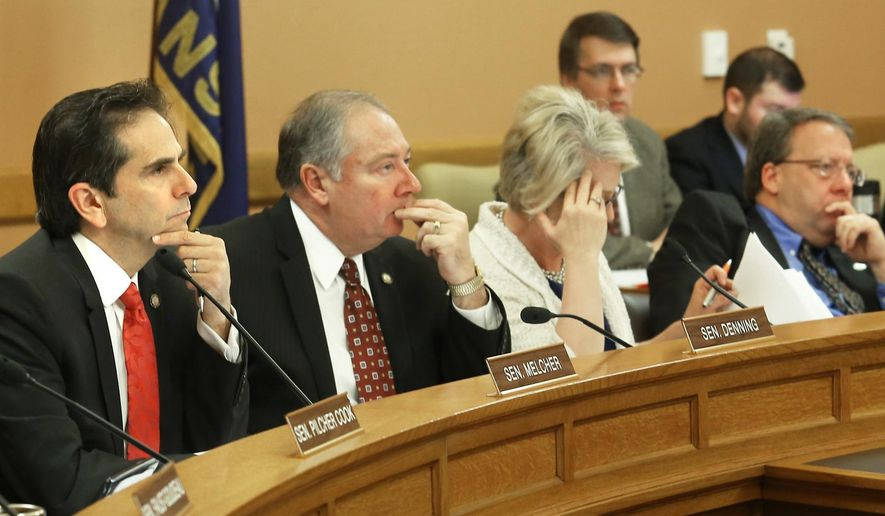 Members of the Senate Commerce Committee listen Tuesday, March 31, 2015, in Topeka, Kan., during a hearing on House Bill 2391 that would ease the way for state agencies to move employees out of the civil service system. (AP Photo/The Topeka Capital-Journal, Thad Allton)