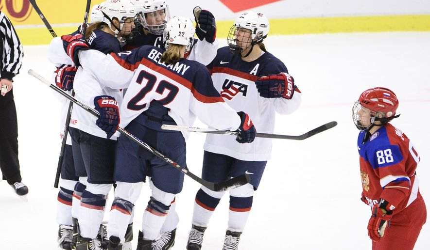 US players celebrate a goal  while Russia's Yekaterina Smolina, right, look on during the 2015 Women's Hockey World Championship group A match between Russia and USA, at Malmo Isstadion in Malmo, southern Sweden, Tuesday, March 31, 2015.  (AP Photo/TT, Claudio Bresciani) SWEDEN OUT