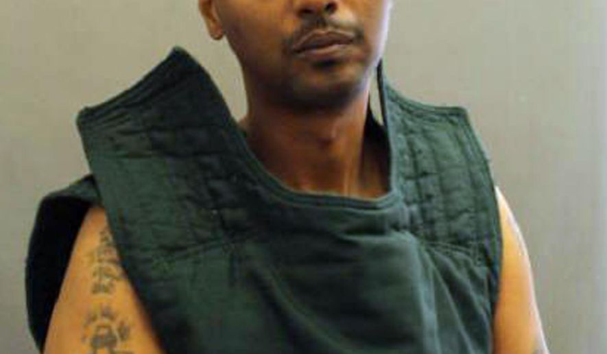 This undated photo provided by the Fairfax County Police Department, in Virginia, shows prisoner Wossen Assaye. Police locked down Inova Fairfax Hospital in Falls Church, Va., early Tuesday, March 31, 2015, and closed area roads while they searched for Assaye, who they say is armed and dangerous after he escaped custody. (AP Photo/Fairfax County Police Department)