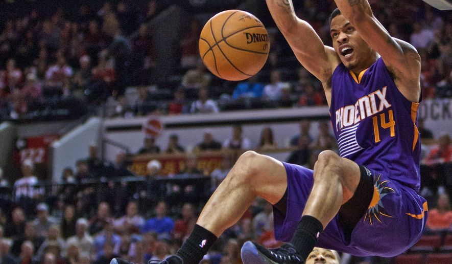 Phoenix Suns guard Gerald Green dunks against the Portland Trail Blazers during the second quarter of an NBA basketball game in Portland, Ore., Monday, March 30, 2015.  (AP Photo/Craig Mitchelldyer)