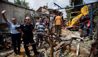 Israeli police officers secure a destroyed house that was hit by a rocket fired by Palestinians militants from Gaza, in Yahud, a Tel Aviv suburb near the airport, central Israel, Tuesday, July 22, 2014. As a result, Delta Air Lines and U.S. Airlines decided to cancel their scheduled flights to Israel. (Associated Press) **FILE**
