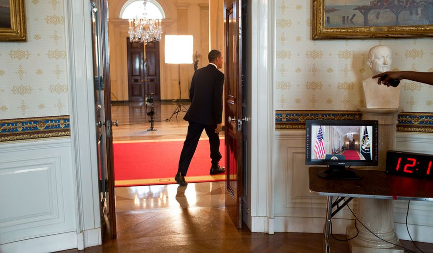 """President Barack Obama walks through the Cross Hall of the White House before delivering a statement about the Supreme Court's ruling on the """"Patient Protection and Affordable Care Act,"""" June 28, 2012. (Official White House Photo by Pete Souza)"""