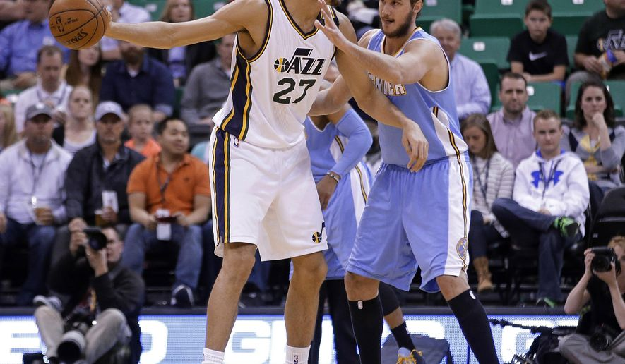Denver Nuggets forward Danilo Gallinari, right, guards Utah Jazz center Rudy Gobert (27) during the first quarter in an NBA basketball game Wednesday, April 1, 2015, in Salt Lake City. (AP Photo/Rick Bowmer)