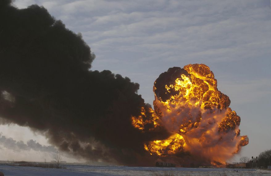 FILE - In this Dec. 30, 2013 file photo, a fireball goes up at the site of an oil train derailment in Casselton, N.D.  On Tuesday, March 31, 2015, Bryan Thompson, of Fargo, N.D., the engineer of the oil tanker train involved in the derailment, filed a complaint against BNSF Railway, accusing the railroad of negligence. Thompson says BNSF failed to properly inspect and maintain its equipment and failed to warn him of the dangers of hauling explosive oil tank railcars. (AP Photo/Bruce Crummy, File)
