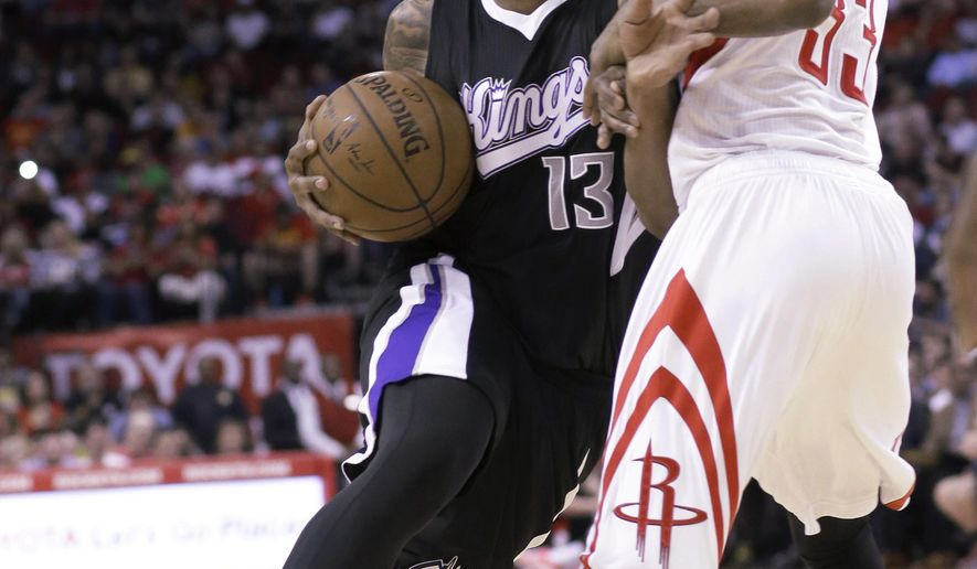 Sacramento Kings' Derrick Williams (13) pushes on Houston Rockets' Corey Brewer (33) in the first half of an NBA basketball game Wednesday, April 1, 2015, in Houston. (AP Photo/Pat Sullivan)