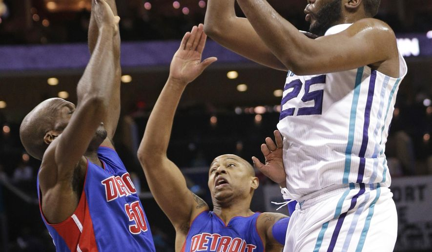 Charlotte Hornets' Al Jefferson (25) shoots over Detroit Pistons' Joel Anthony (50) and Caron Butler (31) during the first half of an NBA basketball game in Charlotte, N.C., Wednesday, April 1, 2015. (AP Photo/Chuck Burton)
