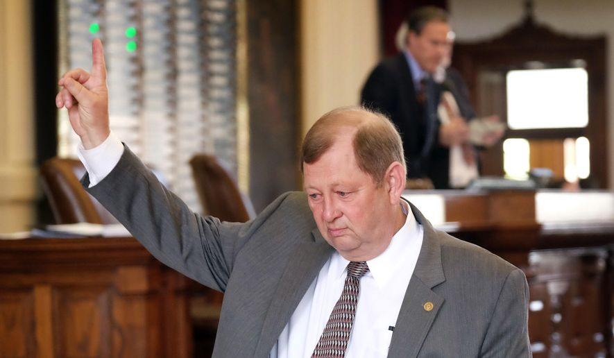 State Rep. John Otto, R-Dayton, House Appropriations Chairman and author of House Bill 1, raises a finger to vote to table an amendment as debate for the appropriations bill began on the House floor of the State Capitol at the state Capitol, Tuesday, March 31, 2015, in Austin, Texas. (AP Photo/Austin American-Statesman, Rodolfo Gonzalez)  AUSTIN CHRONICLE OUT, COMMUNITY IMPACT OUT, INTERNET AND TV MUST CREDIT PHOTOGRAPHER AND STATESMAN.COM, MAGS OUT