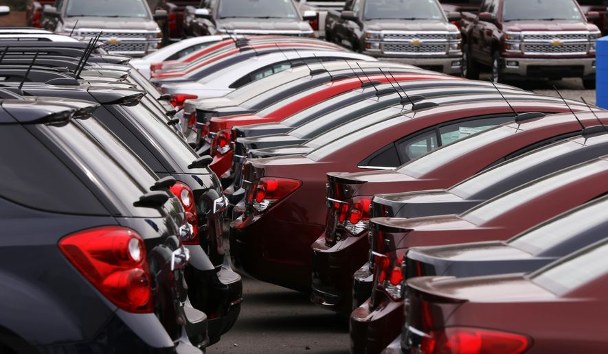 In this Monday, March 23, 2015 photo, Chevrolet vehicles are on display at a dealership in Gibsonia, Pa. Automakers release vehicle sales for March on Wednesday, April 1, 2015. (AP Photo/Gene J. Puskar)