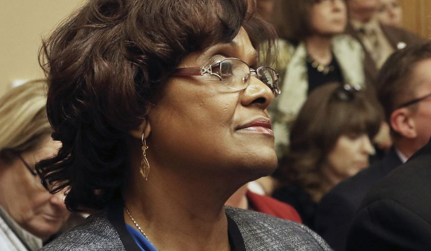 Rep. Valdenia Winn, D-Kansas City, listens as the House Select Investigative Committee held its first meeting Wednesday, April 1, 2015, in Topeka, Kan. Six Kansas legislators are reviewing a complaint against a Winn over her remarks during a committee meeting. (AP Photo/Topeka Capital-Journal, Thad Allton)