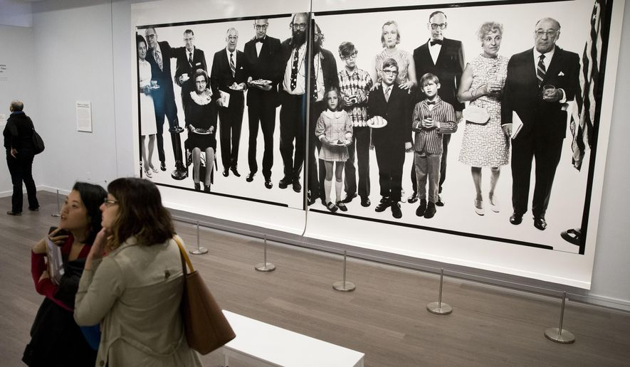 """People view the exhibit titled """"Richard Avedon: Family Affairs"""" Tuesday, March 31, 2015, during the press preview at the National Museum of American Jewish History in Philadelphia. The exhibit features dozens of newsmakers in U.S. culture and politics.  (AP Photo/Matt Rourke)"""