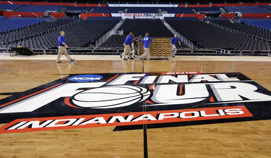 "FILE - In this May 27, 2015, file photo, workers at Lucas Oil Stadium install the court in Indianapolis as they prepare to host the men's NCAA Final Four college basketball games on April 4 and 6, 2015. NCAA officials say they are troubled by the new law in Indiana that critics fear could permit discrimination against gays and lesbians, and they ""will assess all our championships in the state of Indiana,"" including next year's women's Final Four. Other sports organizations from the Indianapolis Motor Speedway, to the NBA's Pacers to the PGA have all scrambled to tell the public that they oppose discrimination. (AP Photo/Michael Conroy, File)"