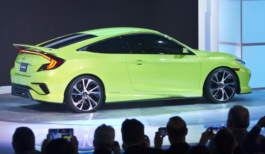 The ultra-sporty Honda Civic Concept car is presented at the New York International Auto Show, Wednesday, April 1, 2015.  (AP Photo/Bebeto Matthews)