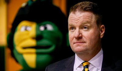 Dave Paulsen waits at the start of a news conference in Fairfax, Va., Wednesday, April 1, 2015, announcing him as the new George Mason men's basketball coach. Paulsen, who was a three-time Patriot League coach of the year at Bucknell University, replaces Paul Hewitt, who went 66-67 in four seasons at George Mason. (AP Photo/Andrew Harnik)