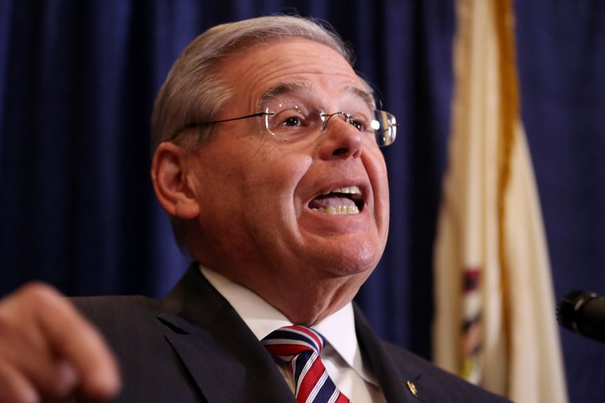 U.S. Sen. Bob Menendez speaks during a news conference, Wednesday, April 1, 2015, in Newark, N.J. Menendez, the top Democrat on the U.S. Senate Foreign Relations Committee, was indicted on corruption charges, accused of using his office to improperly benefit an eye doctor and political donor. (AP Photo/Craig Ruttle)