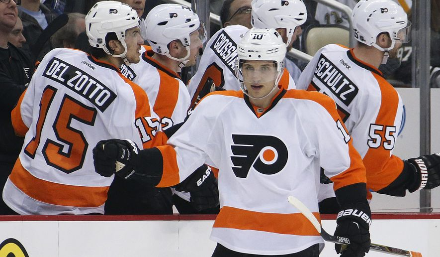 Philadelphia Flyers' Brayden Schenn (10) returns to his bench after his goal in the second period of an NHL hockey game against the Pittsburgh Penguins in Pittsburgh Wednesday, April 1, 2015. (AP Photo/Gene J. Puskar)
