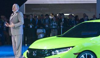John Mendel, senior vice president, automobile operations of American Honda Motor Co., introduce the ultra-sporty Civic Concept car at the New York International Auto Show, Wednesday, April 1, 2015. (AP Photo/Bebeto Matthews) ** FILE **