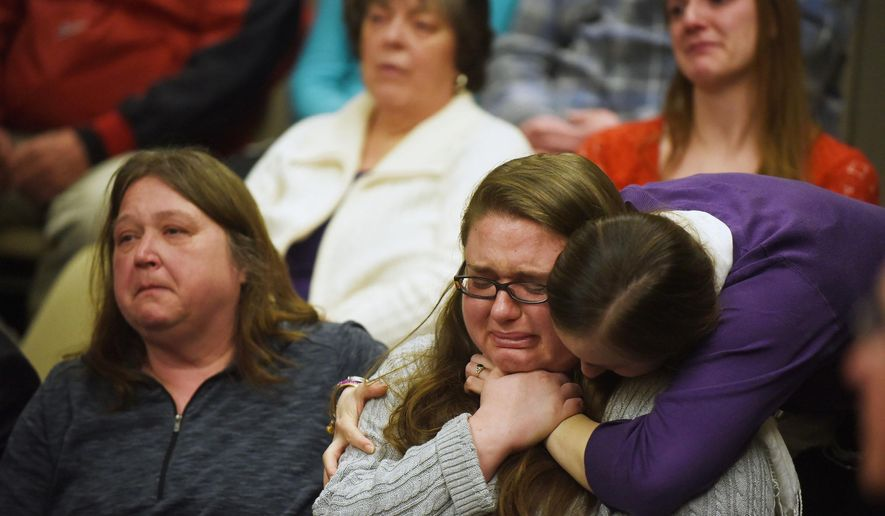 Amanda Murphy's mother, Tammy Langlois, and Murphy's sister, Ashley Murphy, cry after speaking about the moment they learned of the accident that killed Murphy, her unborn child, and her fiancee, Jason Timmons, during Robert Dellinger's sentencing at the Grafton County Superior Court in North Haverhill, N.H., on Wednesday, April 1, 2015. (AP Photo/Valley News, Sarah Priestap)
