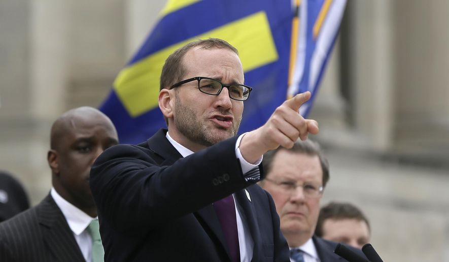 Chad Griffin, national president of the Human Rights Campaign, speaks at a rally at the Arkansas state Capitol in Little Rock, Ark., Wednesday, April 1, 2015. Arkansas Gov. Asa Hutchinson earlier Wednesday called for changes to a religious objection measure that provoked a backlash from businesses and gay-rights groups, saying it was not intended to sanction discrimination based on sexual orientation. (AP Photo/Danny Johnston)