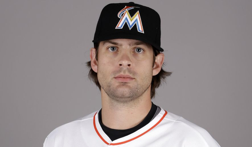 "FILE - This is a 2015, file photo showing Aaron Crow of the Miami Marlins baseball team. Doctors have told Miami reliever Aaron Crow he needs season-ending elbow ligament-replacement surgery. Crow will get a second opinion but expects to have the procedure. ""That's a big blow for him,"" manager Mike Redmond said Wednesday, April 1, 2015. (AP Photo/Jeff Roberson, File)"