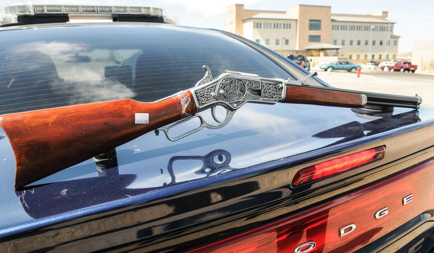 A toy rifle, modeled after an 1894 Winchester, is displayed on the truck of a Las Cruces Police cruiser on Wednesday, April 1, 2015, after it caused panic at Mountain View Regional Medical Center Plaza in Las Cruces, N.M. Police said a 12-year-old boy visiting the medical building with family members had the toy rifle. (AP Photo/Las Cruces Sun-News, Robin Zielinski)