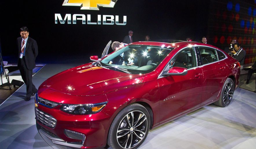 The 2016 Chevrolet Malibu Hybrid, which uses technology from the Chevrolet Volt, is introduced at the New York International Auto Show, Wednesday, April 1, 2015. The Malibu Hybrid is expected to offer an estimated 48 mpg city, 45 mpg highway.  (AP Photo/Bebeto Matthews)