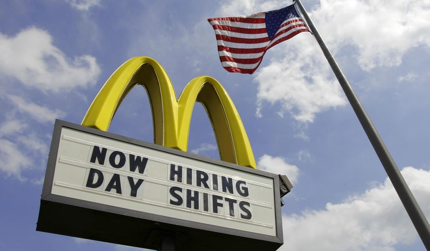 FILE- This May 2, 2012, file photo shows a sign advertising job openings outside a McDonalds restaurant in Chesterland, Ohio. McDonald's on Wednesday, April 1, 2015 said it's raising pay for workers at its company-owned U.S. restaurants, making it the latest employer to sweeten worker incentives in an improving economy. (AP Photo/Amy Sancetta, File)