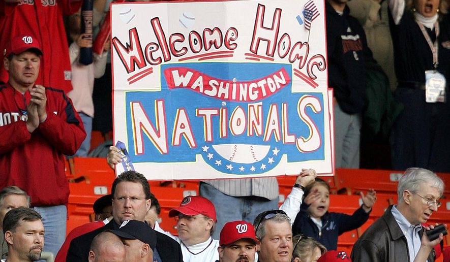 A fan holds up a sign before the Washington Nationals home opener against the Arizona Diamondbacks Thursday, April 14, 2005, in Washington.  (AP Photo/Susan Walsh)