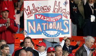 A fan holds up a sign before the Washington Nationals home opener against the Arizona Diamondbacks Thursday, April 14, 2005, in Washington.  (AP Photo/Susan Walsh)