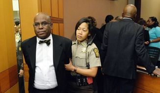 Donald Bullock, left, former Atlanta Public Schools Usher-Collier Heights Elementary testing coordinator, is led to a holding cell after a jury found him guilty in the Atlanta Public Schools test-cheating trial, Wednesday, April 1, 2015, in Atlanta. AP Photo/Atlanta Journal-Constitution, Kent D. Johnson, Pool)