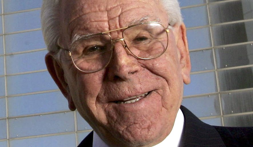 The Rev. Robert A. Schuller poses for a photo outside the Crystal Cathedral in Orange, Calif., in this Feb. 9, 2006, file photo. Schuller, the Southern California televangelist who founded the world-famous Crystal Cathedral, is ailing and could be in his final days, his daughter Carol Schuller Milner said, Wednesday, April 1, 2015. (AP Photo/Chris Carlson, File)