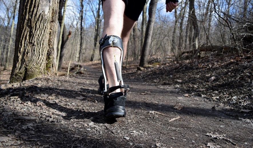 This handout photo provided by Carnegie Mellon University, taken in March 2015, shows an exoskeleton boot on a person walking in a park in Pittsburgh. Engineers at Carnegie Mellon University have developed an exoskeleton boot that makes it easier to walk, burning less calories. When engineers tested the invention they did so by having people wear a pair of the devices, not one. (AP Photo by Lisa Lau/Carnegie Mellon University)   (AP Photo, Lisa Lau, Carnegie Mellon University Experimental Biomechatronics Lab)